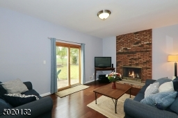Great family room with striking brick wood-burning fireplace. (never used)