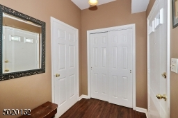 Coat closet and mudroom off foyer with raw plumbing for a 1st floor laundry room!