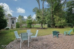Paver patio in the nice  yard