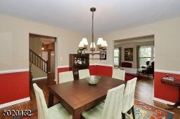Nice formal dining room with a chair rail.