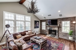Family Room with lots of light, wood burning fire place, hardwood floors, entrance to deck.