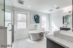 Updated Primary bath with soaking tub, radiant heat floors.