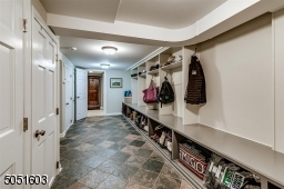 Lower level Mud Room that leads to garage. Lots of storage & extra space.