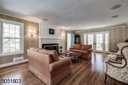 Living Room with hardwood floors & fire place, Doors leading to deck.