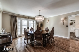 Formal Dining Room with hardwood floors, door leading to deck.