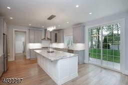 Wood Cabinets, SS Appliances, Quartz Counters