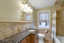Hall bathroom with shower over tub