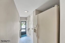Hallway to powder room, pantry and patio.