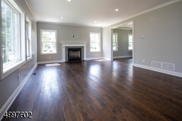 """The Family Room is completely open to the kitchen, providing a great opportunity to entertain. Majestic 42"""" Gas Fired Fireplace."""