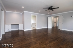This Master Suite has a ceiling fan, recessed lights, vanity, impressive en-suite bathroom and an amazing walk-in closet.