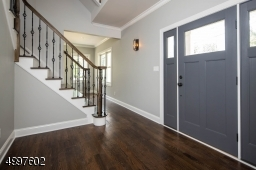 Upon entering the front door, admire the finer details like the wrought iron railing.