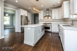 Stainless steel appliances and wonderful white cabinetry really beautify this kitchen.