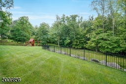 Enjoy this private open back yard that backs up to woods.