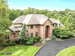 Circular driveway takes you to this stunning 3 sided brick home with a beautiful custom Mahogany front door.