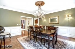 This 16X16 foot dining room is great for entertaining guests.  I love the molding details. It also flows to the kitchen and Butler's Pantry.