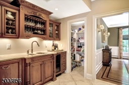 Fabulous Butler's Pantry complete with sink, dishwasher and wine refrigerator. Can you see the full pantry closet in this room?