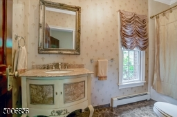 Classic looking  full bathroom, 1 full and 1 half bathroom on the first floor.