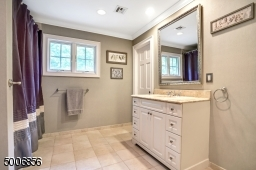 This full bathroom has its own bedroom.  Enjoy the radiant heated flooring.