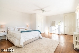 One of 3 bedrooms on the 2 floor. Three big windows fill this room with light. There are 2 closets and hardwood floors.