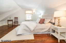 Third floor bedroom with one closet and 2 attic areas w/has storage and HVAC