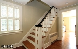 Freshly painted entry foyer w/2 closets