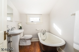 Full bath on 3rd floor with large soaking tub and hardwood floor