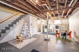 High ceiling can easily be finished in this dry basement w/toilet, laundry, storage, utilities and workshop