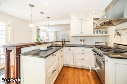 Gourmet kitchen with custom cabinets, granite counters and Viking appliances