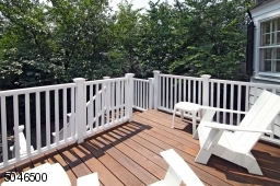 Deck off of the kitchen overlooks the driveway and backyard.
