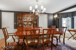 BANQUET  SIZE DINING ROOM OPENS TO KITCHEN