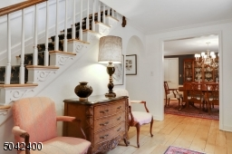 NOTICE RADOM WIDTH WOOD FLOORS. FLOWS TO DINING AND LIVING ROOMS.