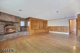 WOW! plenty of space to entertain! look at the room sizes in this home.  Fireplace #2!
