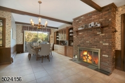 Imagine having your morning coffee next to the fireplace in the kitchen! 1 of 3 fireplaces.