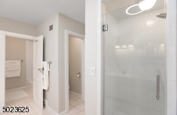 Stall Shower, Tub and Walk-in Closet