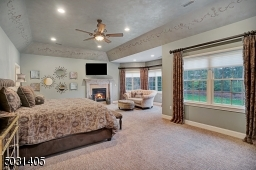 Tasteful Master Suite with gas fireplace, sitting area & lots of natural light.