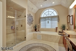 Discerning Master bath with jetted tub, large  shower and double sink vanity with make up counter