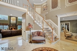 Two story foyer with Marble floor & custom Moldings