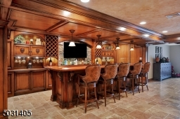 Amazing space for your guests - sophisticated custom cabinets & built ins this wet bar has a dishwasher/ice machine & wine refrigerator