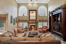 Two story room with gas fireplace