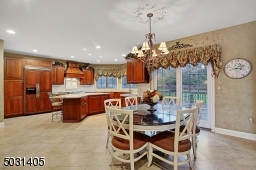 Gourmet kitchen with separate dining area with sliders out to a deck