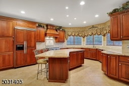 All Viking Appliances including a 6 burner gas range and additional wall oven/granite counters