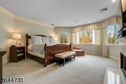 Master suite offers gas fireplace, double walk in closets, and private den