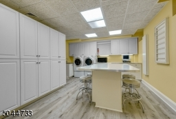 1 of 2 laundry rooms. Tons of storage cabinets