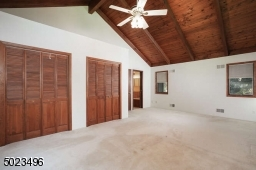 Located at the end of the hallway with an abundance of natural light.
