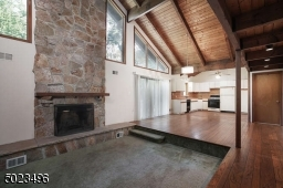 Floor to ceiling magnificent wood burning fireplace.