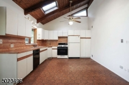 Spacious kitchen is open to the dining area and LR with sliders to deck.