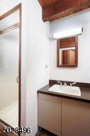 Stall shower, separate area with laundry hookups if desired.