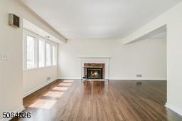 With gleaming hardwood floors