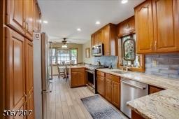 New granite countertops, blue subway tile backsplash, tile flooring, and all SS appliances.