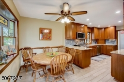 Large eat in area overlooking yard with radiant heat tile flooring.